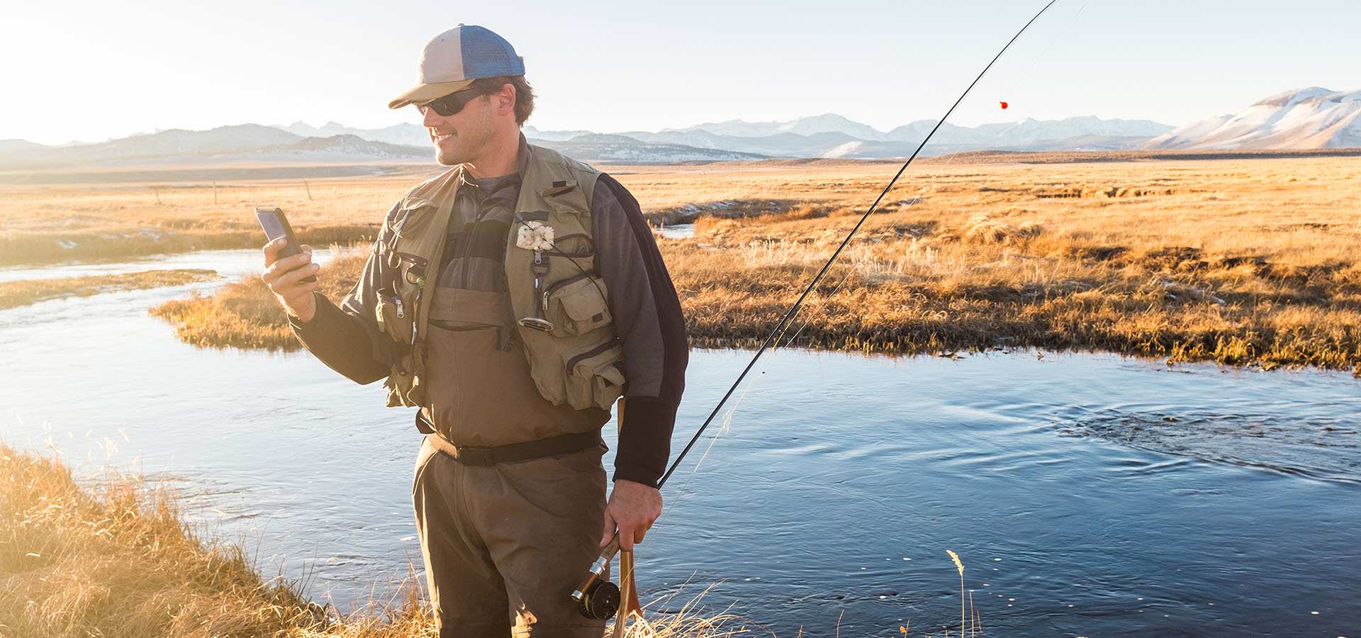 Slide - Fly fisherman using cell phone